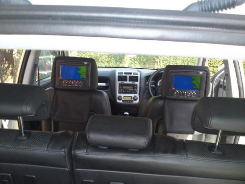 Universal Dvd headrest in a Kia