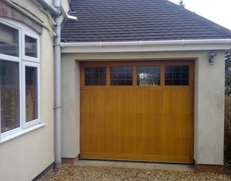 Cedar Garage Door timber Sectional fully finished in light oak with diamond lead windows