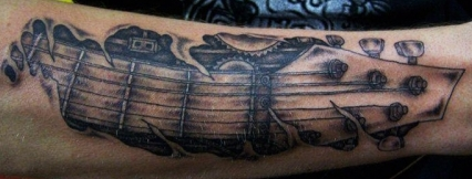 West Coast Tattoos' Black & Grey work by Blan. Guitar arm.