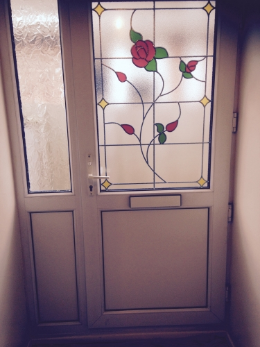 After new glass and upvc panels fitted to old door