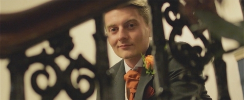 The Groom viewed through a staircase railing.