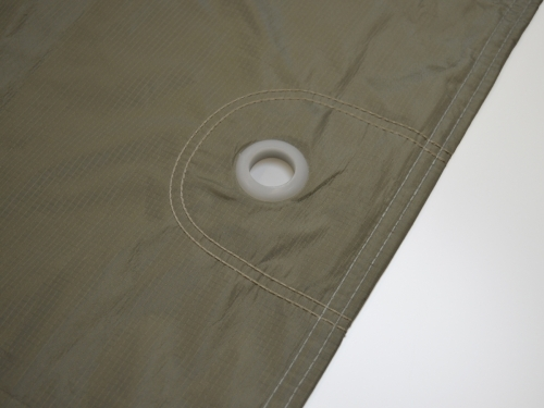 Eleylets sewn into the car cover