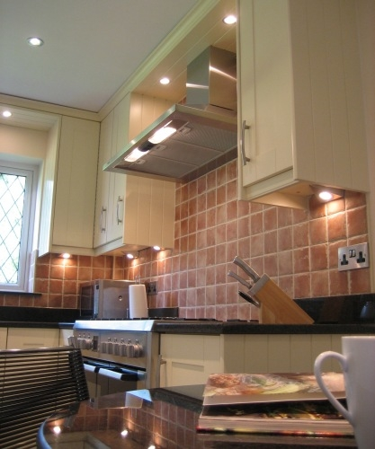 Classic Shaker painted cream cabinets with black granite worktops - Complete replacement kitchen for Mr & Mrs Foster, Wokingham