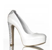 Athina is Bridal shoe handcrafted from soft leather displaying a lovely silk like sheen, embellished with heart shaped Swarovski crystals detail on the heel.