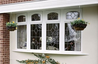 4 Section leaded bow window with dummy arches
