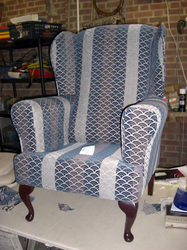 Wing arm chair reupholsterd with legs back on