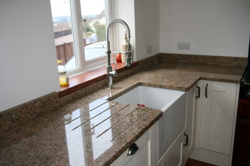 Giallio Veneziano granite kitchen worktop with Belfast sink in Aldershot, Hampshire
