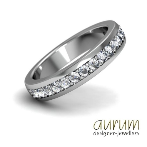Platinum wedding ring with pavé-set diamonds