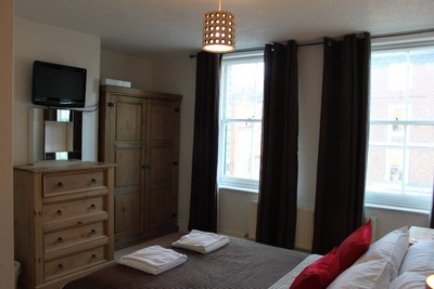 2nd floor Suite with Memory foam bed, includes a small lounge